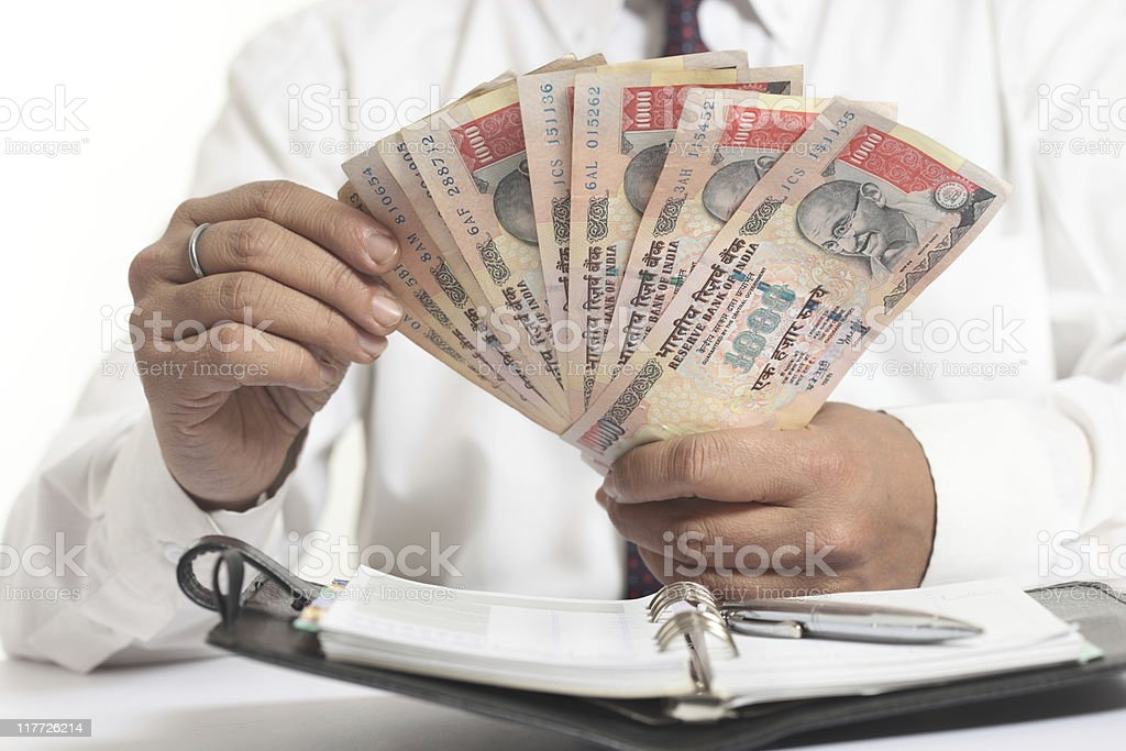 Counting Rupees stock photo