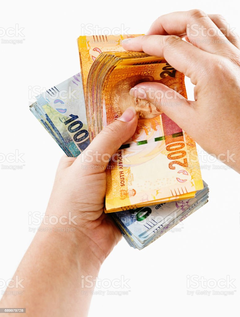 Counting South African money: hands riffle through banknotes stock photo