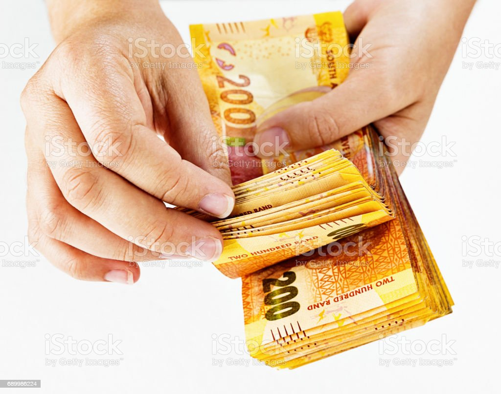 Counting South African Two Hundred Rand banknotes in close up stock photo