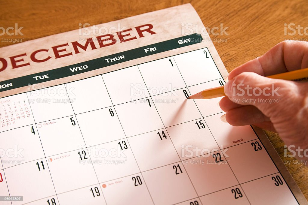 Counting the days until Christmas on December calendar. Hand. royalty-free stock photo