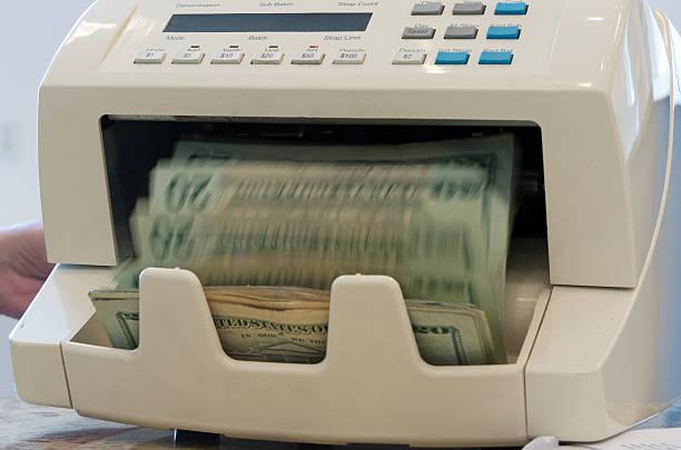 Zählen Sie das Geld – Foto