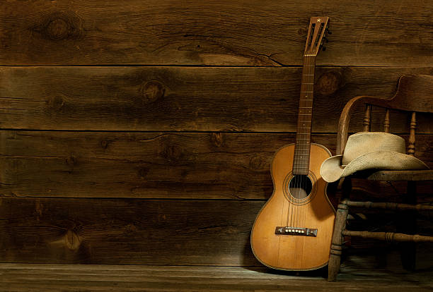 Country and Western Music scene w/chair,hat,guitar-barnwood background stock photo