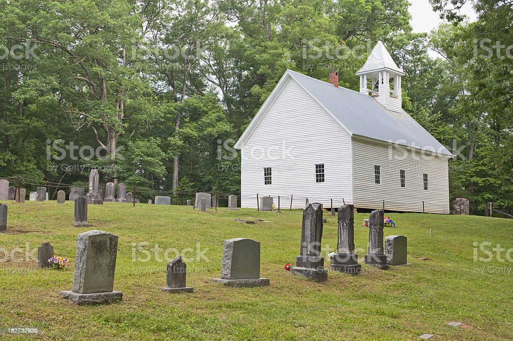 Country church with graveyard stock photo