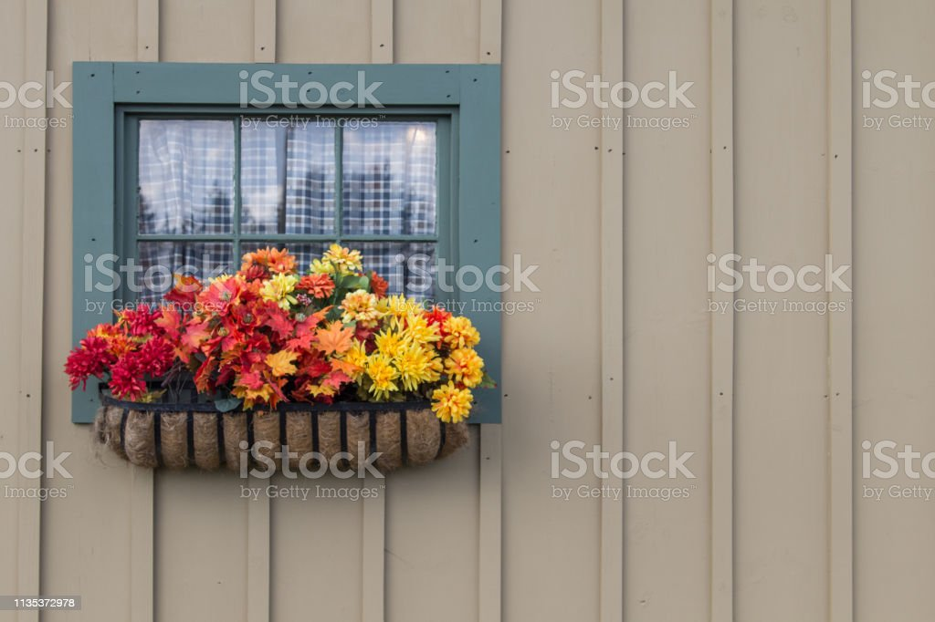 Country Cottage With Window And Flower Planter stock photo