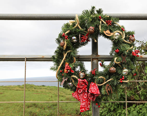 Country Cowboy Christmas Wreath Cowboy themed Christmas Wreath hanging on a ranch gate in the tropics. neicebird stock pictures, royalty-free photos & images