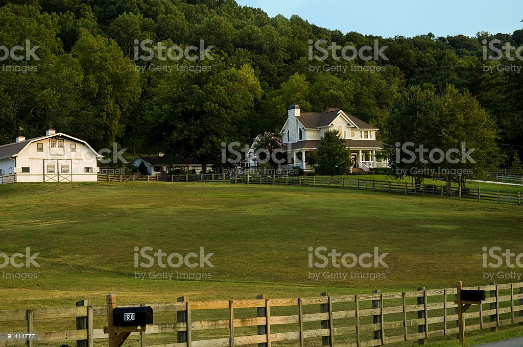 Country Farm with White Barn and White House or Home stock photo
