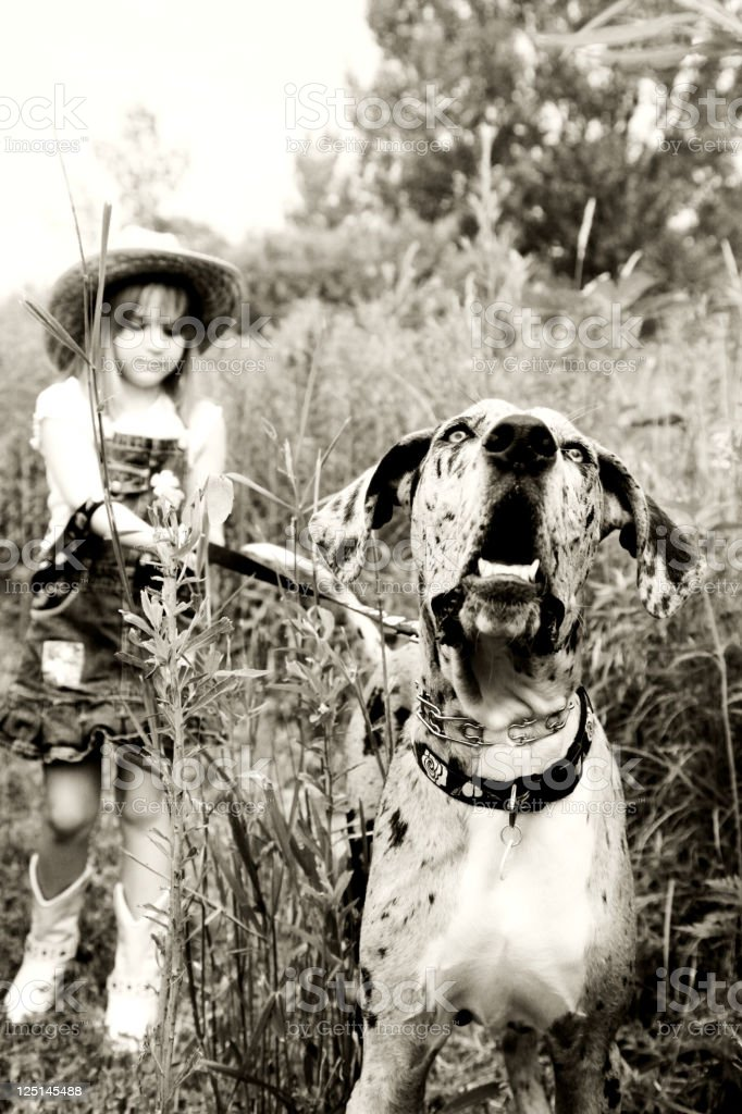 Country girl and her dog royalty-free stock photo