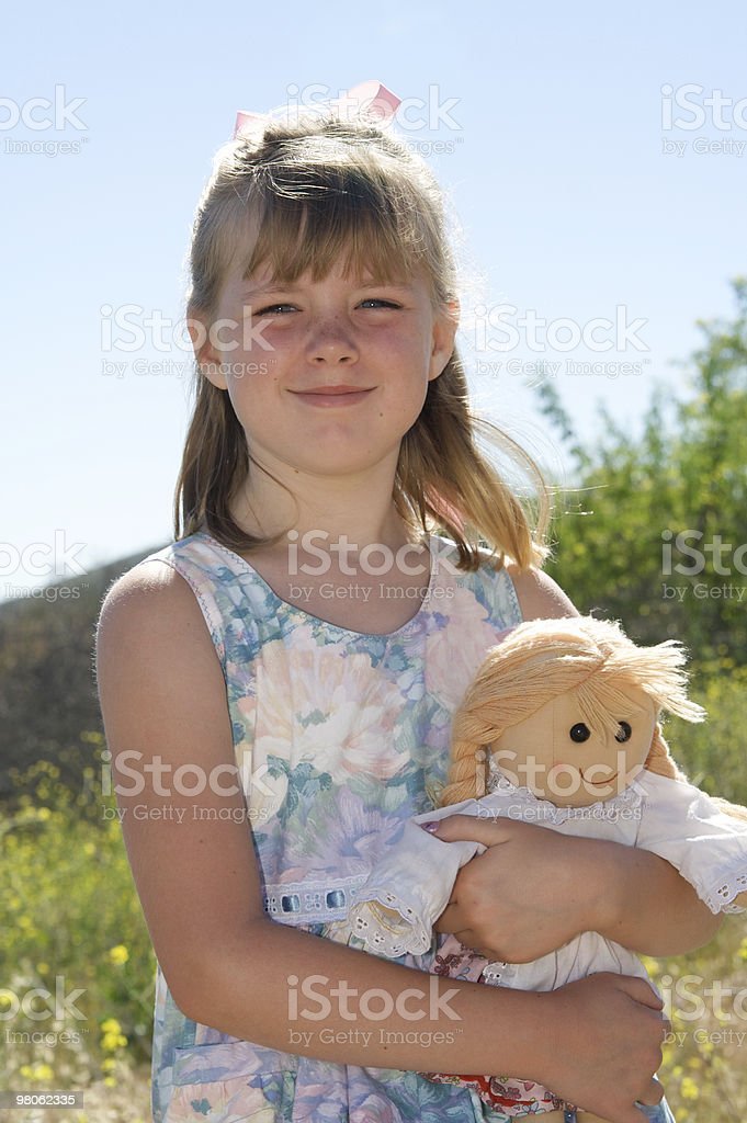 Country Girl and Her Doll royalty-free stock photo
