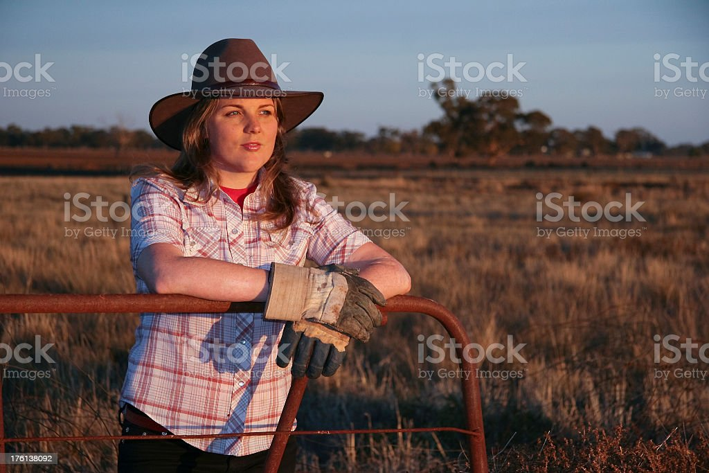 Country girl looking toward the horizon to the right stock photo