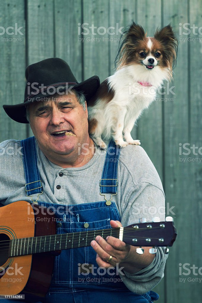 Country Guitar Player with Dog royalty-free stock photo