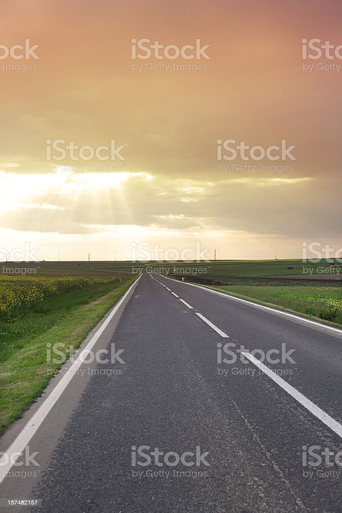 Country highway and dramatic evening sky. royalty-free stock photo