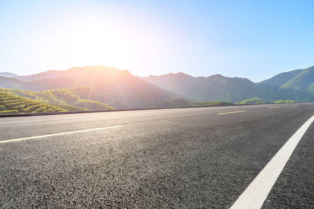Country highway and green mountains natural landscape stock photo