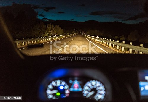 istock Country highway at night - Driver's point of view 1015495968