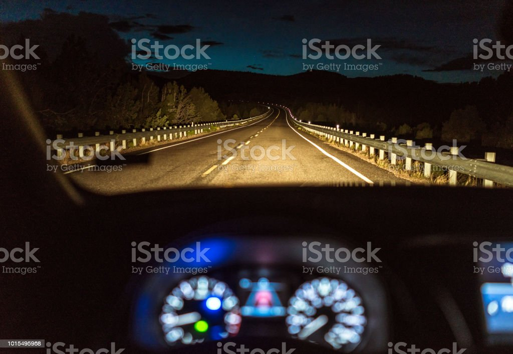 Country highway at night - Driver's point of view stock photo