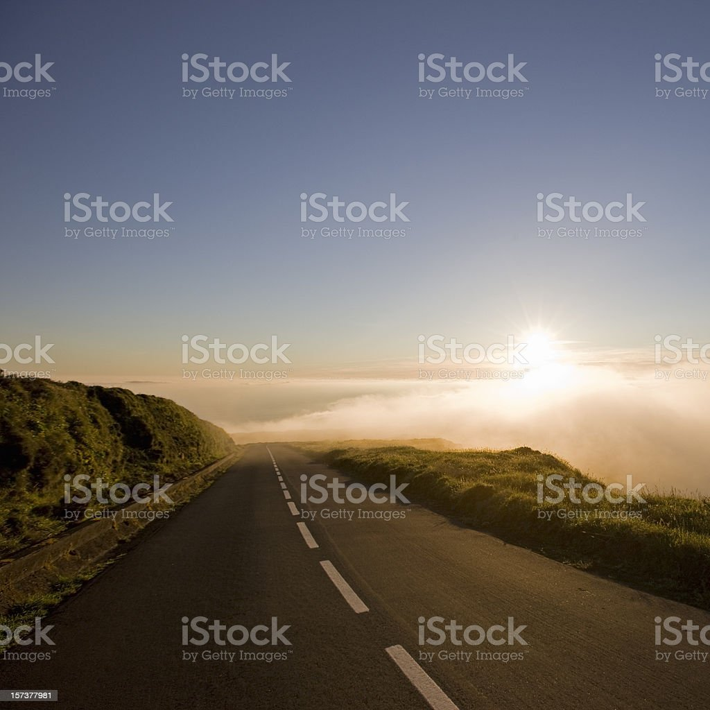 Country Highway into Clouds during Sunset royalty-free stock photo