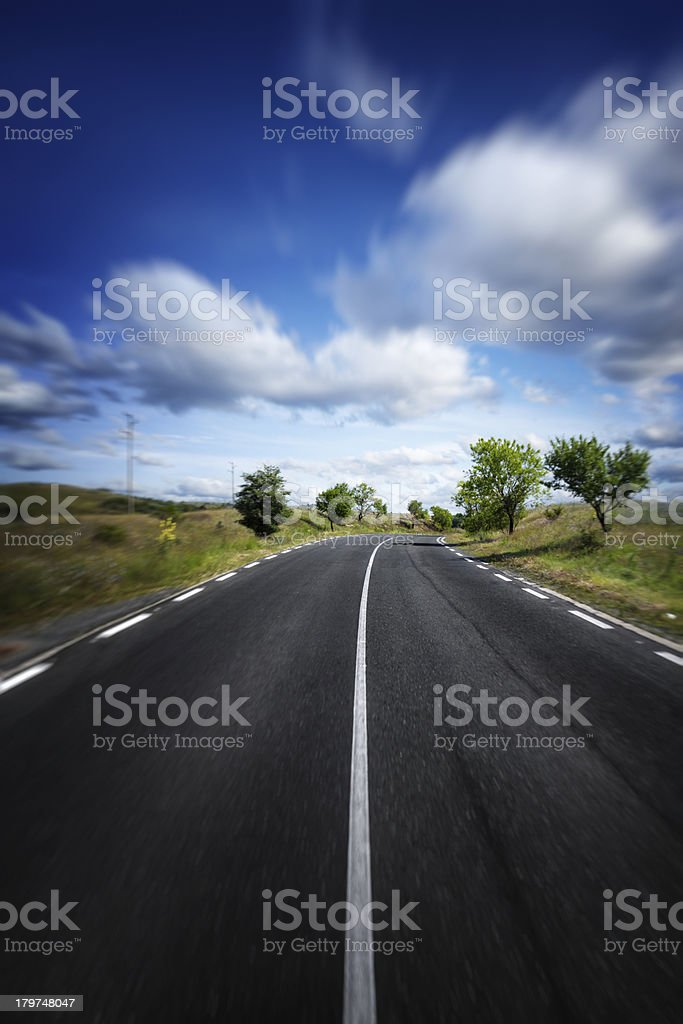 Country highway through the forest royalty-free stock photo