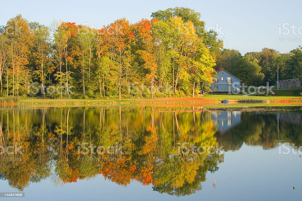 Country house next to lake stock photo
