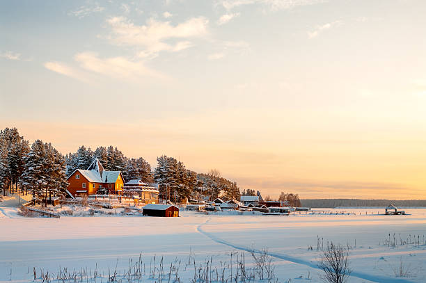Country house on lake shore in winter sunset lights Country house on lake shore in winter sunset lights russian dacha stock pictures, royalty-free photos & images