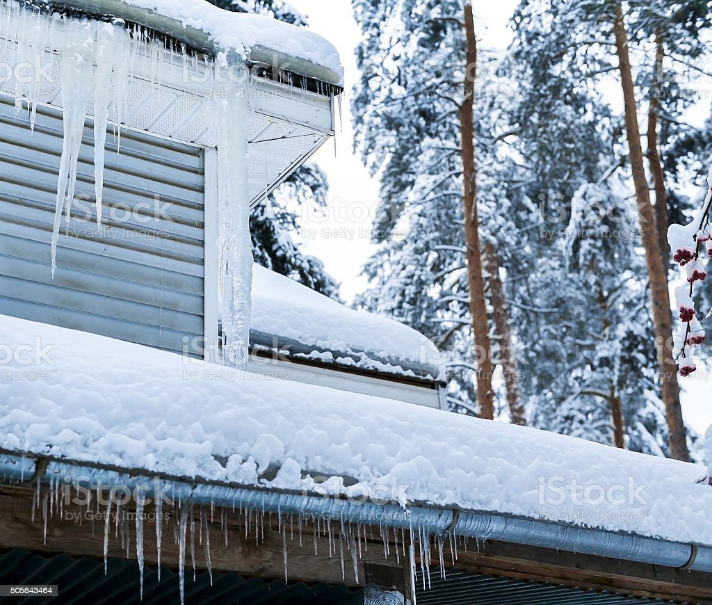 Country house with icicles stock photo