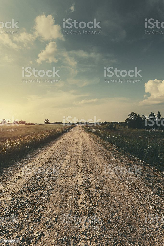 Country Landscape - fields in the sunset sky stock photo