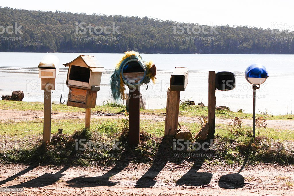 Country letter boxes for multiple houses stock photo