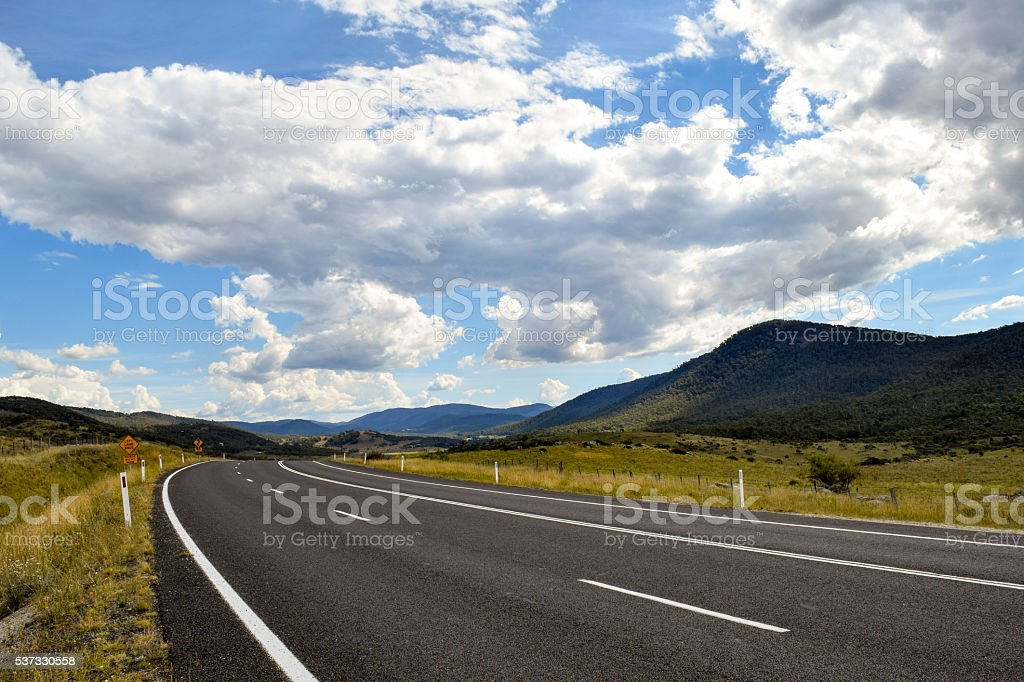 Country main road fading into the mountain distance, Thredbo Valley stock photo