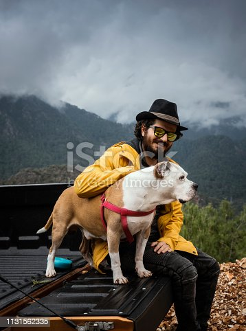 Country man and his dog on a road trip