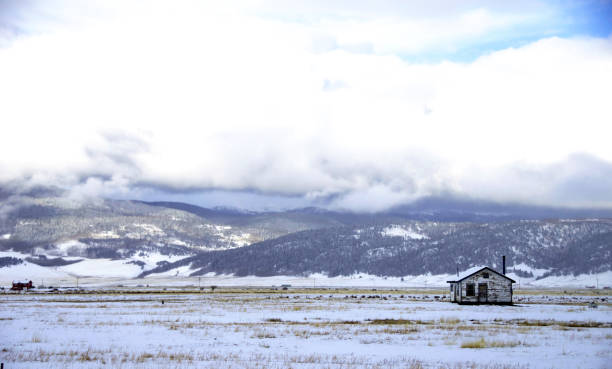 Country mountain home in the winter. stock photo