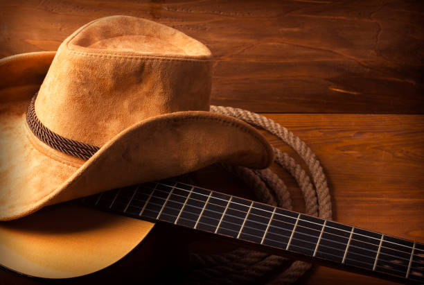 fond de musique country avec guitare - chapeau de cow boy photos et images de collection