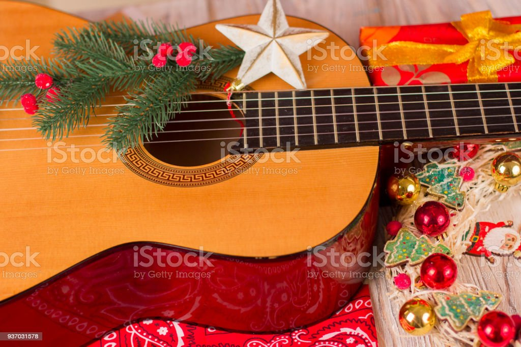 country music christmas background with guitar and cowboy bandanna royalty free stock photo - Christmas Background Music