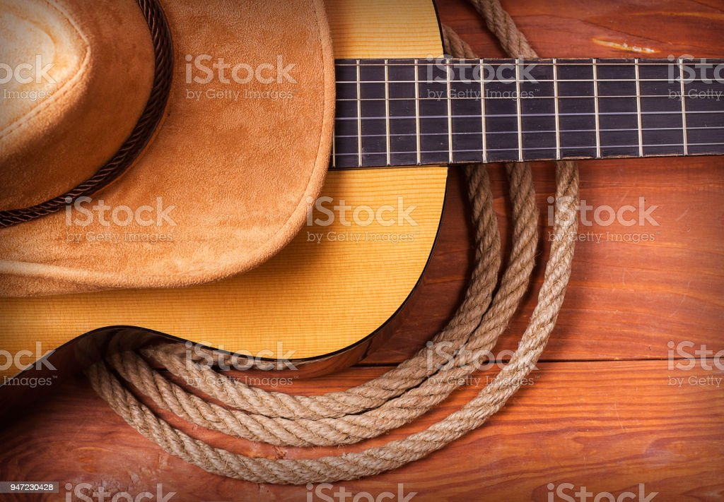 Country music picture with guitar and cowboy hat and rope stock photo