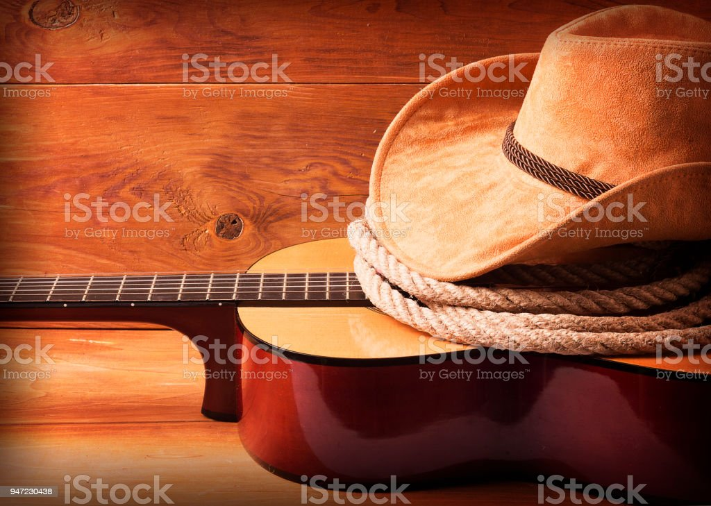 Country music picture with guitar and cowboy hat stock photo