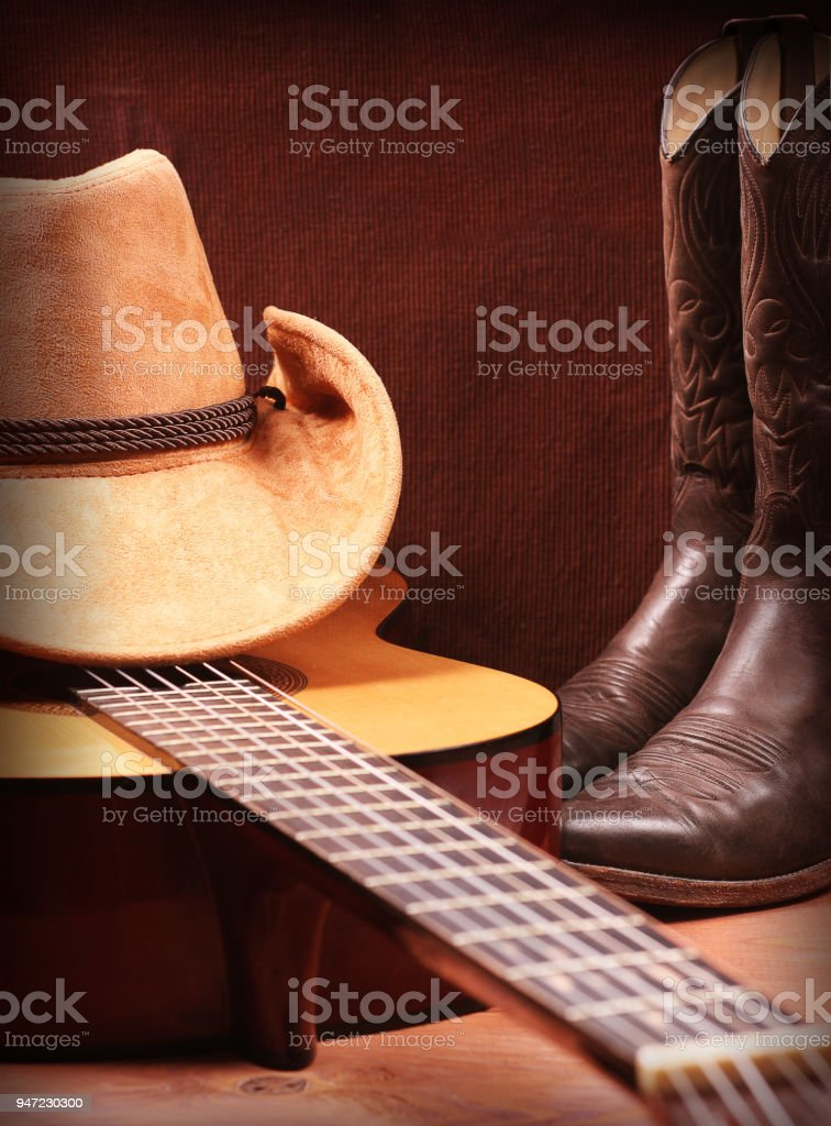 Country music with guitar and cowboy clothes stock photo