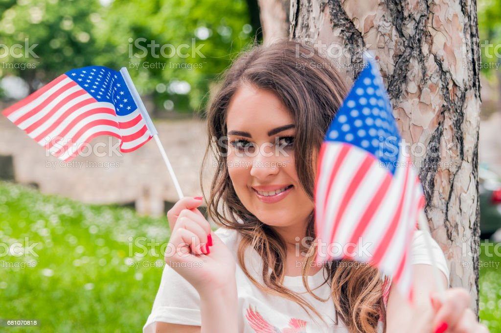 country, patriotism, independence day and people concept stock photo