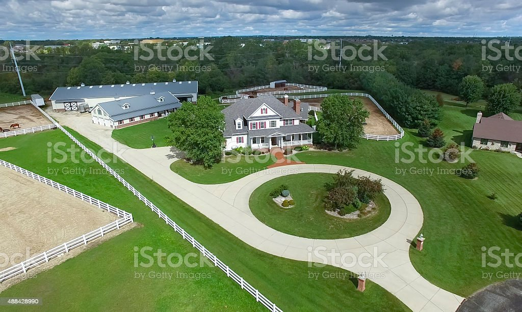 Country ranch, mansion with horse barns and pens. stock photo