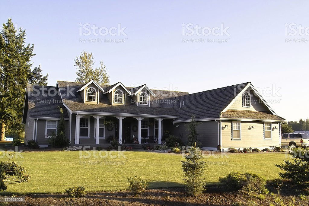 Country Ranch Style Home Photograph of a modern country home at sunset. Blue Stock Photo