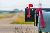 Country road and mail boxes, rural Alberta near Devon.
