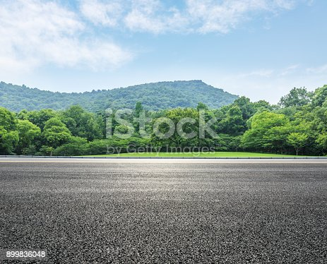 istock country road and mountains with forest in summer 899836048