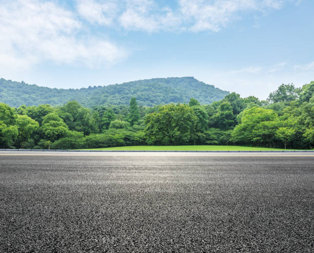 country road and mountains with forest in summer country road and mountains with forest landscape in summer side view stock pictures, royalty-free photos & images