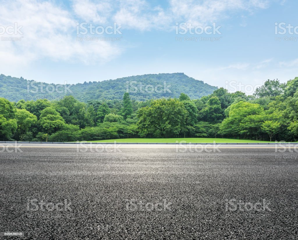 country road and mountains with forest in summer stock photo