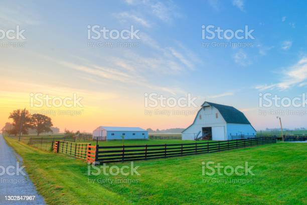 Photo of Country road at sunrise-with barn and fence-Howard County, Indiana