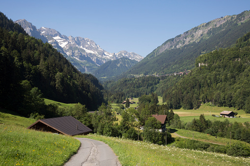 Country road in Val de Illiez with on the background Champery in Switzerland.