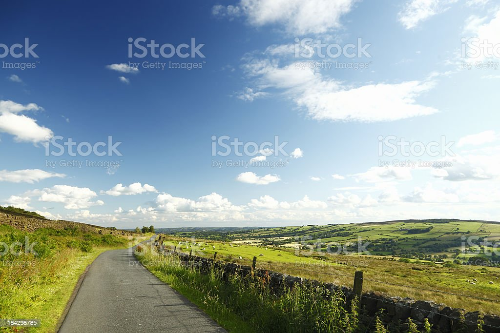 Country Road Leading into the Countryside royalty-free stock photo