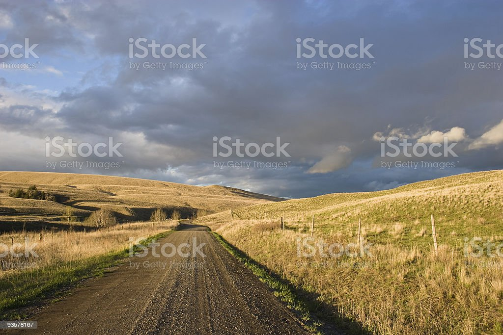 Country road leading nowhere stock photo