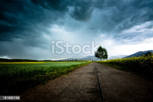 country road with dramatic storm clouds.adobe rgb 1998 use...........