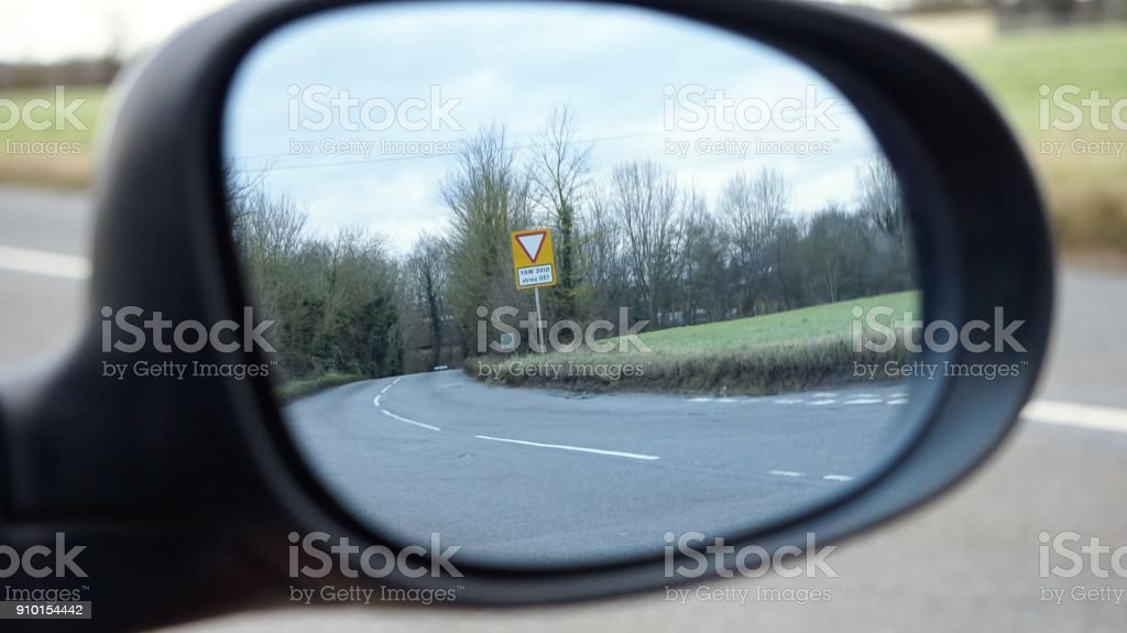 Country Road Scene in a Car's Wing Mirror stock photo