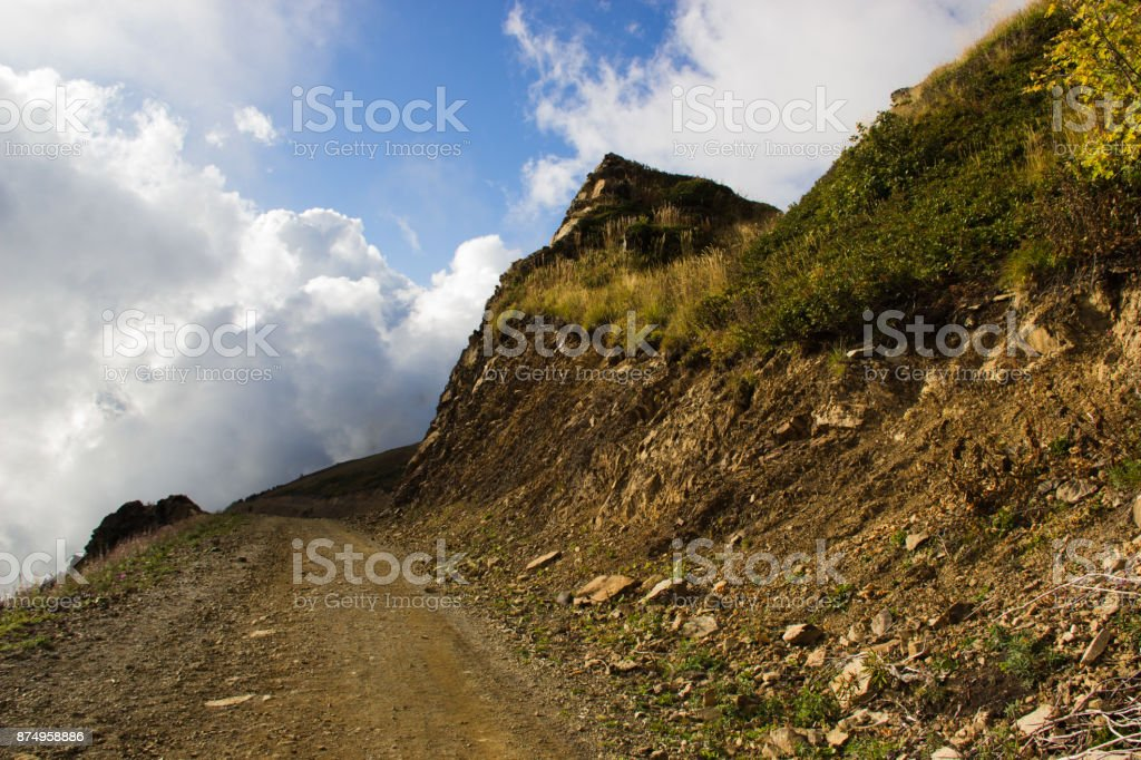 A country road that goes into low-lying clouds stock photo
