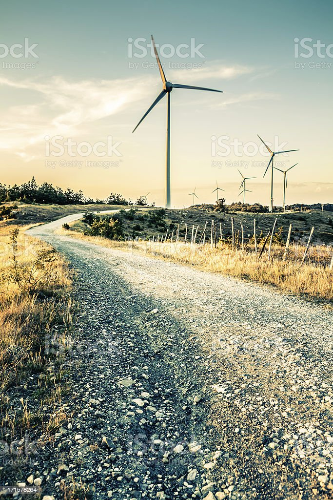 Country Road to the Wind Turbines, Alternative Energy in Tuscany stock photo