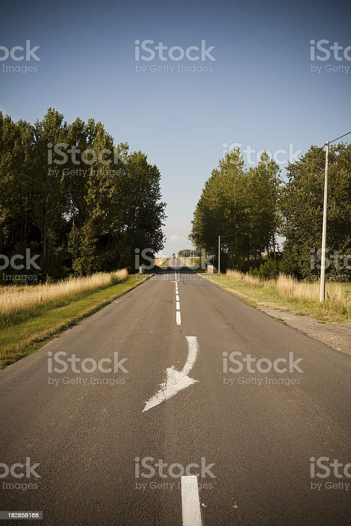 Country road with arrow marking royalty-free stock photo