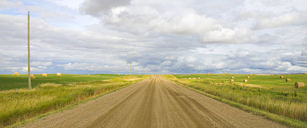 Country Road with farmers field Panorama stock photo